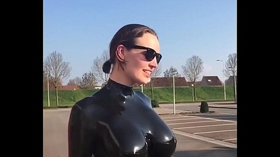 woman regarding latex