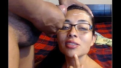 adorable latina takes facial cumshot on glasses